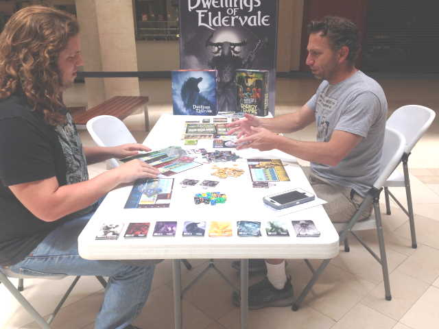 2 players playing the Dwellings Of Everdale Boardgame